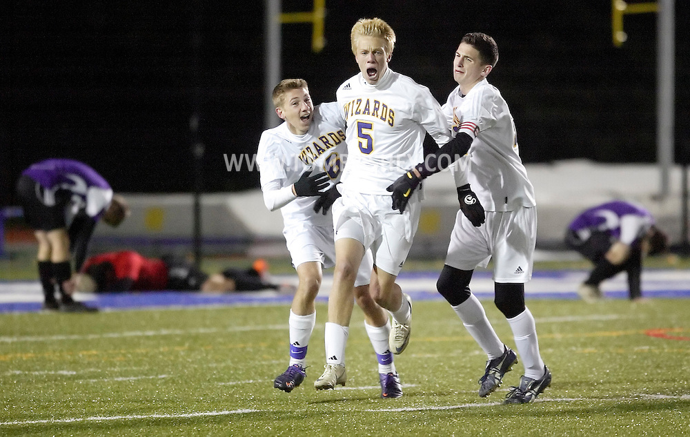 Washingtonville's Kurt Fluhler (5) celebrates with teammates Tim Coffey, left, and Kevin Aussenheimer after scoring in overtime to give the Wizards a 2-1 victory in the Section 9 Class AA boys' soccer championship game.