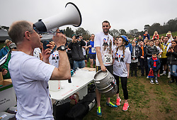 **CAPTION CORRECTION ON SPELLING OF WINNERS NAME**<br /> &copy; Licensed to London News Pictures. 08/04/2018. Dorking, UK. Winners of the race CHRIS HEPWORTH AND TANISHA PRINCE  are presented with a barrel of beer. Competitors take part in the 2018 annual Wife Carrying Race in Dorking, Surrey. The race, which is run over a course of 380m, with both men and women carry a 'wife' over obstacles, is believed to have originated in the UK over twelve centuries ago when Viking raiders rampaged into the northeast coast of England carrying off any unwilling local women . Photo credit: Ben Cawthra/LNP