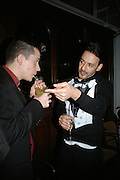 TRISTRAN WEBBER  AND DARREN GANDER, Gap/ Red launch Dinner hosted by  Katie Grand at Bistrotheque. Bethnal Green. London. 29 November 2007.  -DO NOT ARCHIVE-© Copyright Photograph by Dafydd Jones. 248 Clapham Rd. London SW9 0PZ. Tel 0207 820 0771. www.dafjones.com.