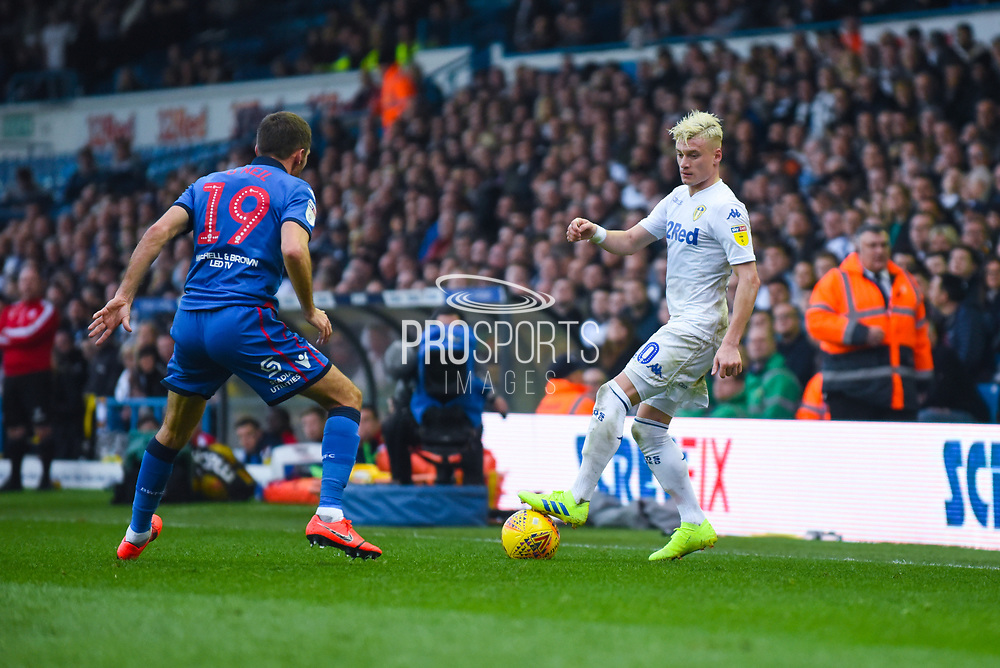 Ezgjan Alioski of Leeds United (10) puts his foot on the ball as Gary O'Neil of Bolton Wanderers (19) defends during the EFL Sky Bet Championship match between Leeds United and Bolton Wanderers at Elland Road, Leeds, England on 23 February 2019.