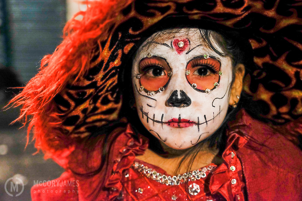 A young girl poses during Dia de los Muertos
