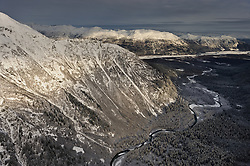 Takhin Ridge (left) towers over the Takhin River in southeast Alaska near Haines. The Takhin River flows into the Chilkat River which is located at the base of the Takshanuk Mountains seen in background.