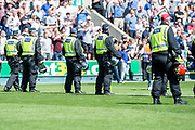 Police on the pitch to stop pitch invasion during the EFL Sky Bet Championship match between Millwall and Aston Villa at The Den, London, England on 6 May 2018. Picture by Robin Pope.