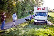 A asparagus (Spargel)  car delivering to customers in a field their goods in Oberursel in times of social distancing because of the corona virus.