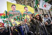 Frankfurt | 18 March 2017<br /> <br /> Am Samstag (18.02.2017) feierten &uuml;ber 30000 Kurden im Rahmen einer Demonstration das kurdische Neujahrsfest Newroz, bei der Demo sprachen sie sich gegen eine Diktatur und f&uuml;r die Freilassung von PKK-F&uuml;hrer Abdullah &Ouml;calan aus.<br /> Hier: Demonstranten in Feierlaune unter Fahnen mit einem Bild von &Ouml;calan,  eine junge Frau hebt die Finger zum Victory-Zeichen.<br /> <br /> photo &copy; peter-juelich.com<br /> <br /> Nutzung honorarpflichtig!