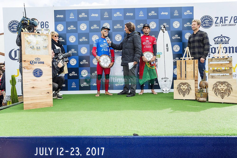 July 18, 2017 - Filipe Toledo of Brazil (blue) and Frederico Morais of Portugal (red) celebrate their result at the Corona Open J-Bay prizegiving.  Toledo is crowned the 2017 Champion, his second Championship Tour career victory and Morais takes runner-up, the first final of his rookie year...Corona Open J-Bay, Eastern Cape, South Africa - 18 Jul 2017. (Credit Image: © Rex Shutterstock via ZUMA Press)
