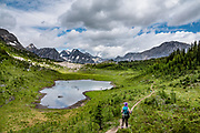 At Putnik's Pond, admire the limestone fangs of Mounts Maude, French (3244 m), and Jellico. Day hike from Forks Campground to North Kananaskis Pass (13 miles round trip/2700 ft) in Peter Lougheed Provincial Park, Kananaskis Country, Alberta, Canada.