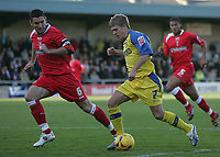 Photo: Lee Earle.<br /> Torquay United v Swindon Town. Coca Cola League 2. 18/11/2006. Torquay's Jamie Ward (R) is tracked by Ady Williams.
