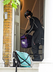 © Licensed to London News Pictures. 15/06/2019. London, UK.  A Deliveroo food delivery arrives at the home Conservative Party leadership candidate Boris Johnson and his partner Carrie Symonds in south London on June 15, 2019. Photo credit: Ben Cawthra/LNP