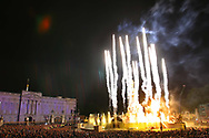 Crowds outside Buckingham Palace watching the opening burst of a firework display at the end of a rock concert held in the palace grounds to celebrate Queen Elizabeth II's Golden Jubilee. Celebrations took place across the United Kingdom with the centrepiece a parade and fireworks at Buckingham Palace, the Queen's London residency. Queen Elizabeth ascended to the British throne in 1952 upon the death of her father, King George VI.