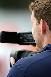 19 September 2015:  Videographer Chris Highland during an NCAA division 3 football game between the Simpson College Storm and the Illinois Wesleyan Titans in Tucci Stadium on Wilder Field, Bloomington IL