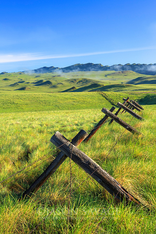 Fence along bluebird highway in central Montana.