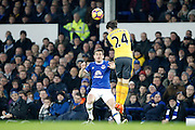 Arsenal's Hector Bellerin (24) clears the danger from Everton's  Leighton Baines (3) during the Premier League match between Everton and Arsenal at Goodison Park, Liverpool, England on 13 December 2016. Photo by Craig Galloway.