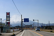 A van drives past Mount Fuji on a road in Gotemba, Shizuoka, Japan. Thursday March 26th 2020