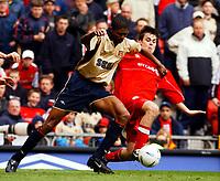 Fotball:<br /> Engelsk FA-cup, semifinale. 14.04.2002.<br /> Arsenal v Middlesbrough.<br /> Kanu, Arsenal.<br /> Robbie Stockdale, Middlesbrough.<br /> Foto: Tim Parker, Digitalsport.