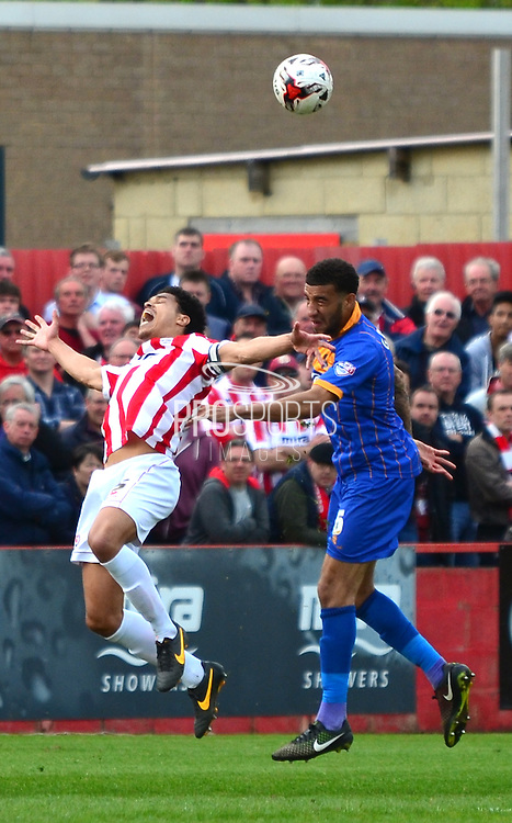 Connor Goldson wins a header against Troy Brown during the Sky Bet League 2 match between Cheltenham Town and Shrewsbury Town at Whaddon Road, Cheltenham, England on 25 April 2015. Photo by Alan Franklin.