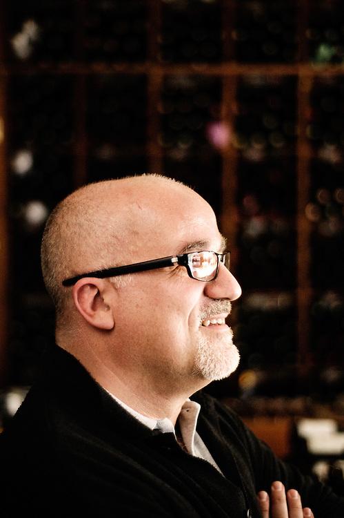 Portrait de Marc Sibard, negociant en vins naturels et proprietaire des caves Auges, boulevard Hausmann. Paris, France, le 2 avril 2009.