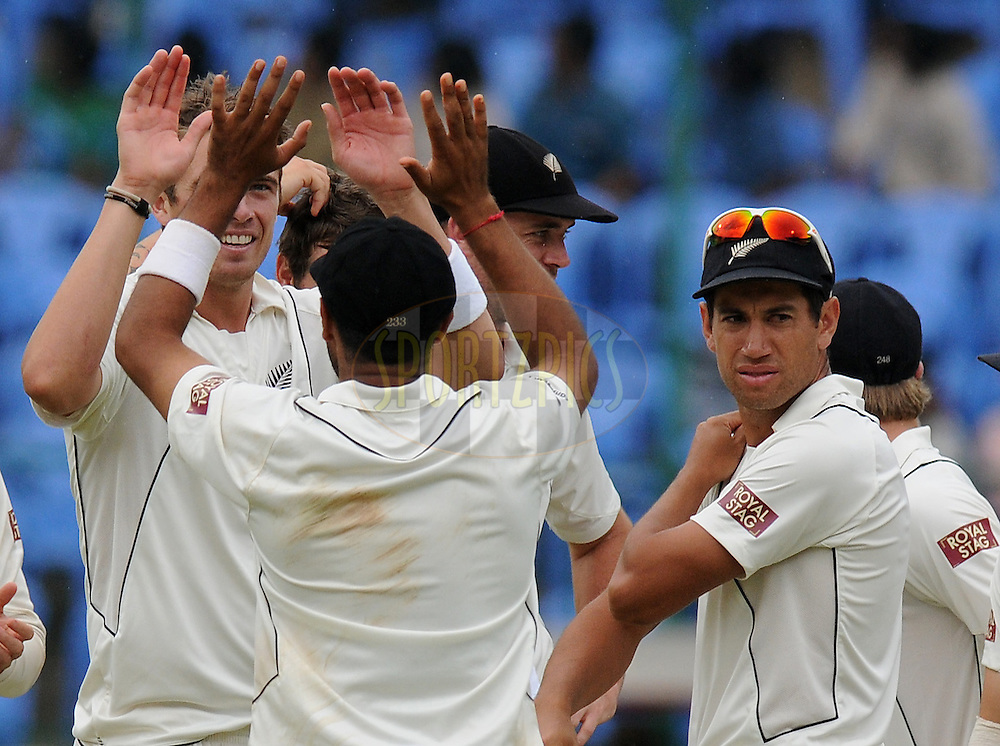 Tim Southee of New Zealand celebrates the wicket of  Sachin Tendulkar of India during day four of the second test match between India and New Zealand held at the M. Chinnaswamy Stadium, Bengaluru on the 3rd September 2012..Photo by Pal Pillai/BCCI/SPORTZPICS