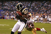 SAN DIEGO - SEPTEMBER 1:  Wide receiver Kassim Osgood #81 of the San Diego Chargers catches a 13 yard touchdown pass in the first quarter while defended by cornerback Shawntae Spencer #36 of the San Francisco 49ers during a preseason game on September 1, 2005 at Qualcomm Stadium in San Diego, California. The Chargers defeated the 49ers 28-24. ©Paul Anthony Spinelli *** Local Caption *** Kassim Osgood; Shawntae Spencer