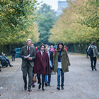 London, UK - 15 October 2014: People walking in Regent's Park during the first day of Frieze Art Fair and Frieze Masters.