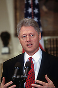 WASHINGTON, DC, USA - 1997/04/01: U.S. President Bill Clinton gives a statement on keeping liquor advertisement off television with Vice President Al Gore in the Roosevelt Room the White House April 1, 1997 in Washington, DC.   (Photo by Richard Ellis)
