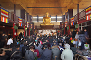 Cambodian buddhists during the Khmer New Year celebrations in the Great Pagoda of the Bois de Vincennes, in the 12th arrondissement of Paris, France, photographed on 14th April 2019. This is the largest buddha statue in Europe at 9m high, and is covered in gold leaf. Cambodians celebrate the entrance of the sun to the constellation of the ram, marking the beginning of the Buddhist year 2563. Khmer New Year or Chaul Chnam Thmey marks the end of the dry season and Cambodians celebrate by bringing offerings to temples or wats. Picture by Manuel Cohen