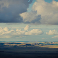 clouds billow over the prairie adjacent to glacier national park conservation photography - montana wild prairie