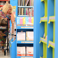 Connie Gusmus, a seventh grade science teacher at Guntown Middle School, shops for paper, notebooks, pencils and other basic school suplies for her classroom at OfficeMax in Tupelo.