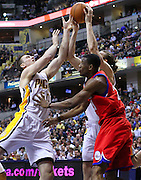 March 14, 2012; Indianapolis, IN, USA; Indiana Pacers power forward Tyler Hansbrough (50) and Indiana Pacers center Louis Amundson (17) battle for a rebound against Philadelphia 76ers forward Thaddeus Young (21) at Bankers Life Fieldhouse. Mandatory credit: Michael Hickey-US PRESSWIRE