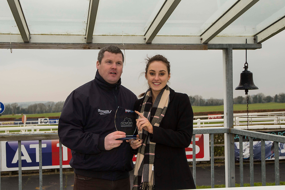 Navan Races, Saturday 27th February 2016.<br /> Tara Armstrong (Navan Racecourse) presents the trophy to trainer Gordon Elliott after General Principle won the Nobber Maiden Hurdle<br /> Photo: David Mullen /www.cyberimages.net / 2016
