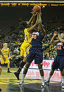 February 24 2011: Iowa Hawkeyes guard Kachine Alexander (21) and Illinois Fighting Illini forward Karisma Penn (00) battle for a rebound during the first half of an NCAA women's college basketball game at Carver-Hawkeye Arena in Iowa City, Iowa on February 24, 2011. Iowa defeated Illinois 83-64.