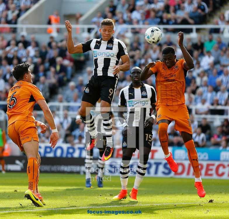Dwight Gayle (9) of Newcastle United has his header blocked by the hand of Dominic Iorfa (r) of Wolverhampton Wanderers during the Sky Bet Championship match at St. James's Park, Newcastle<br /> Picture by Simon Moore/Focus Images Ltd 07807 671782<br /> 17/09/2016