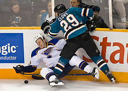 January 6, 2010; San Jose, CA, USA; San Jose Sharks left wing Ryane Clowe (29) knocks St. Louis Blues center Alexander Steen (20) to the ice during the second period at HP Pavilion. San Jose defeated St. Louis 2-1 in overtime. Mandatory Credit: Jason O. Watson / US PRESSWIRE