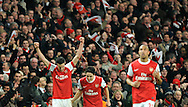Arsenal's Robin Van Persie, left, celebrates after scoring a goal against Barcelona during a Champions League, round of 16, first leg soccer match at Arsenal's Emirates stadium in London, Wednesday, Feb. 16, 2011.