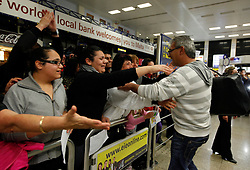 A man (R) arriving from Tripoli on an evacuation flight is welcomed by relatives at Malta International Airport outside Valletta February 23, 2011. .Photo by Darrin Zammit Lupi