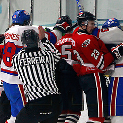 TORONTO, ON - Feb 16 : Ontario Junior Hockey League Game Action between the Milton Ice Hawks and the Toronto Jr. Canadiens, Toronto Junior Canadians Hockey Club become involved in an altercation with the Milton Ice Hawks Hockey Club.<br /> (Photo by Brian Watts / OJHL Images)