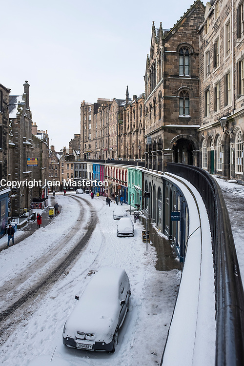 View of historic Victoria Street in Edinburgh Old Town after heavy snow, Scotland, United Kingdom