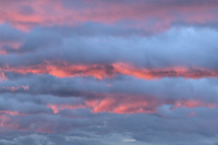 Storm clouds clored purple and blue at sunrise
