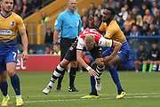 Hayden White of Mansfield Town (2) hauls down Dean Moxey of Exeter City (21) in the box but nothing given during the EFL Sky Bet League 2 match between Mansfield Town and Exeter City at the One Call Stadium, Mansfield, England on 15 September 2018.