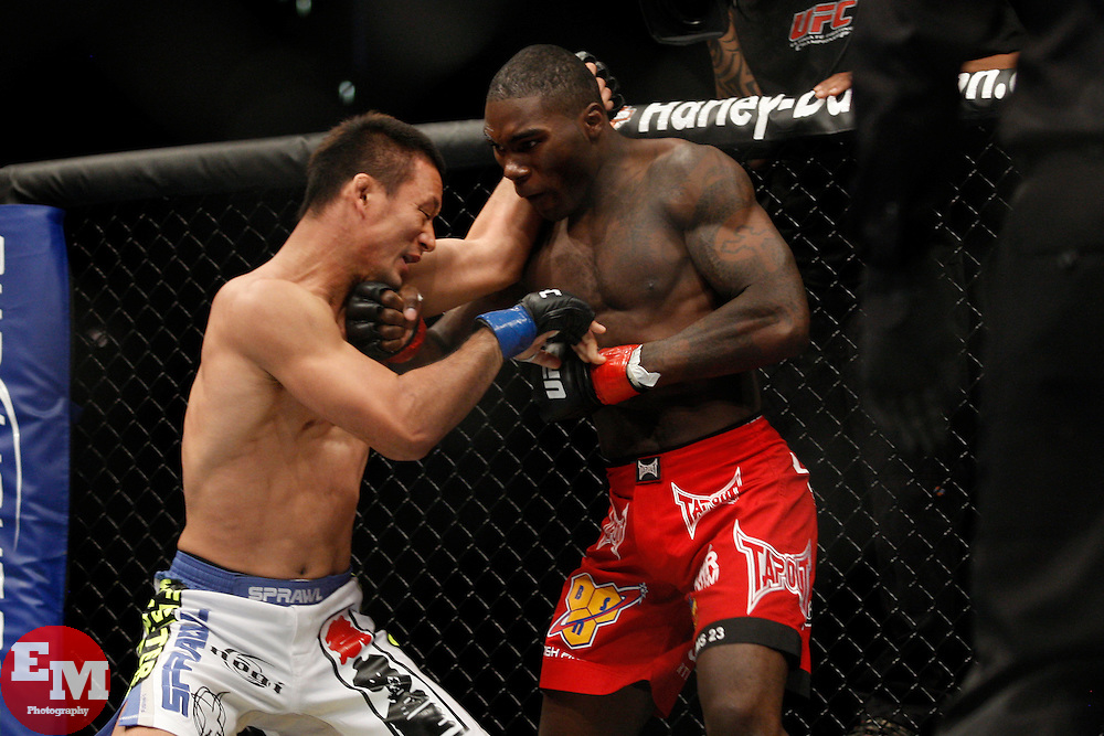 October 24, 2009; Los Angeles, CA; USA; Anthony Johnson (red trunks) lands a right hook to the head of Yoshiyuki Yoshida (white trunks) during their bout at UFC 104.   Johnson won via 1st round KO.  Mandatory Credit:  Ed Mulholland