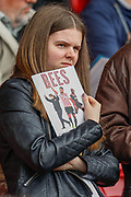 Brentford football fans, football supporters, holding a match programme, before the EFL Sky Bet Championship match between Brentford and Preston North End at Griffin Park, London, England on 5 May 2019.