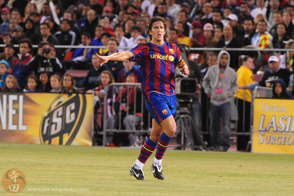 August 8, 2009; San Francisco, CA, USA; FC Barcelona defender Carles Puyol (5) signals during the second half in the Night of Champions international friendly contest against Chivas de Guadalajara at Candlestick Park. The game ended in a 1-1 tie.