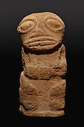 Tiki statue in volcanic tuff, with prominent eyes and open mouth with tongue, 73cm tall, a protective statue representing Ti'i, a half-human half-god ancestor who is believed to be the first man, from Raivavae in the Austral Islands, in the Musee de Tahiti et des Iles, or Te Fare Manaha, at Punaauia, on the island of Tahiti, in the Windward Islands, Society Islands, French Polynesia. The Museum of Tahiti and the Islands was opened in 1974 and displays collections of nature and anthropology, habitations and artefacts, social and religious life and the history of French Polynesia. Picture by Manuel Cohen
