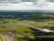 Nederland, Noord-Holland, Gemeente Schermer, 16-04-2012; Driehuizen met het water van De Lei in de Eilandspolder (laagveen gebied, vaarpolder of vaarland). Op het tweede plan de bebouwing van Graft de Rijp met daar achter de Beemster..The village of Driehuizen in the polder originated by peat extraction..luchtfoto (toeslag), aerial photo (additional fee required);.copyright foto/photo Siebe Swart