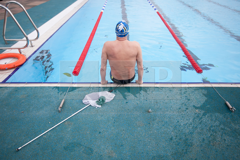 © London News Pictures. 28/03/12. Local former Paralympian medal winner James Muirhead, who lost his sight aged 17,  prepares himself for training in the 50m Olympic sized pool. James is a former Paralympian winning 5 golds, 8 silvers and 3 bronze medals in the late 1970's and early 1980's. Charlton Lido in South London, opens today 28/03/13 after extensive refurbishment work to the heated Olympic sized outdoor pool in Charlton, London, England. Picture credit should read Manu Palomeque/LNP