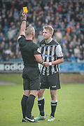 Daniel Middleton (Referee) gives Marcus Carver (Chorley) a yellow card for an earlier infringement in the FC Halifax Town attack during the Vanarama National League North Play Off final match between FC Halifax Town and Chorley at the Shay, Halifax, United Kingdom on 13 May 2017. Photo by Mark P Doherty.
