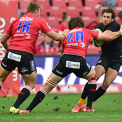 Johannesburg, SOUTH AFRICA, 21, MAY 2016 - during the Super Rugby match between Emirates Lions vs Jaguares ,Emirates Airlines Park,Johannesburg.<br /> Warwick Tecklenburg of the Emirates Lions tackles Nicolás Sánchez of the Jaguares. <br /> <br /> South Africa. (Photographer Christiaan Kotze ) -- (Steve Haag Sports) <br /> <br /> Images for social media must have consent from Steve Haag