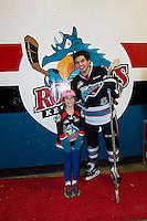 KELOWNA, CANADA - DECEMBER 4: Nick Merkley #10 of Kelowna Rockets stands with a young fan on December 4, 2015 at Prospera Place in Kelowna, British Columbia, Canada.  (Photo by Marissa Baecker/Shoot the Breeze)  *** Local Caption *** Nick Merkley;