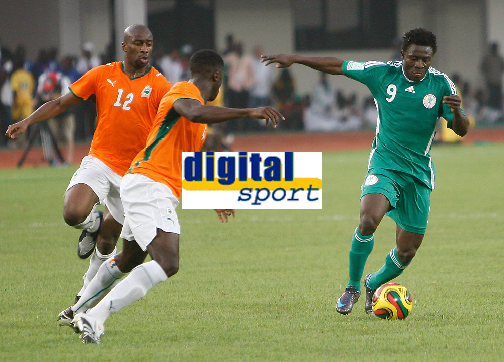 Photo: Steve Bond/Richard Lane Photography.<br /> Nigeria v Ivory Coast. Africa Cup of Nations. 21/01/2008. Obafemi Martins (R) line up to shoot. Kolo Toure (C) and Abdouleye Meite (L) try to close him down