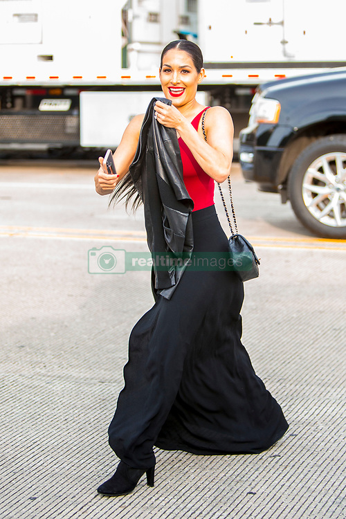 EXCLUSIVE: Total Divas star and fiancee to John Cena, Nikki Bella, is spotted showing off her engagement ring while wearing a tight red vest-top and a long slitted skirt with thigh high boots and long hair in a knot, ahead of the WWE Wrestlemania 34 Hall Of Fame 2018. 06 Apr 2018 Pictured: Nikki Bella. Photo credit: MEGA TheMegaAgency.com +1 888 505 6342